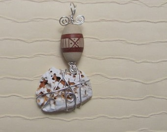 "CD#5 Pendant, ""Off Kilter"", Seashell with silver plated wire and bead"