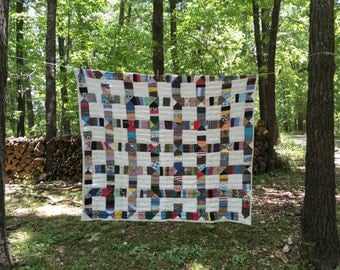 Vintage handstitched quilt.  In good condition with bright colors