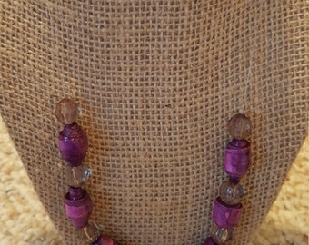 Necklace with purple hand made paper beads also with other contrasting beads and toggle clasp