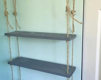 Rustic shelf with rope and pipe
