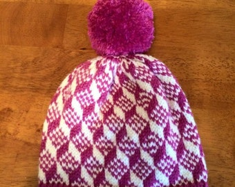Optical illusion knit hat with pompom