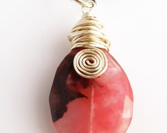 Oval Pink Gemstone with Brown markings