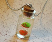 Metroid and Samus in a Bottle Necklace - Glow in the Dark Morph Ball Charm