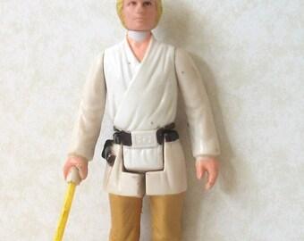 Vintage Star Wars Luke Skywalker 1977 Action Figure with complete telescoping lightsaber