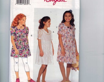 1990s Vintage Sewing Pattern Butterick 3389 Girls Easy Dress with High Waist Leggings Bow Size 7 8 10 12 14 Breast 26 27 28 30 32 UNCUT  99