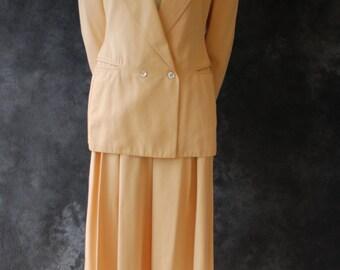 90's Claude Montana peach pants suit.