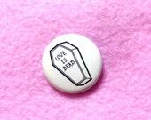 """1"""" Love is Dead Glow in the dark Pinback button by Penelope Gazin"""