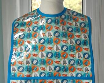 Blue Rocket Adult Bib - vinyl covered regular size adult bib with pocket