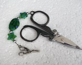 Small folding scissors. Scissor fob with green beads and silver stork scissor charm.