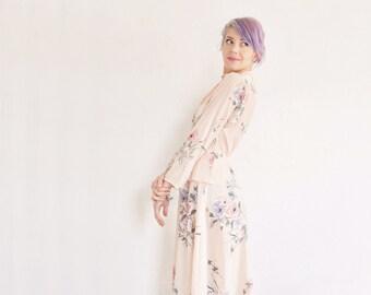peach floral peplum dress . swiss dot pattern and accordion pleats .small.medium