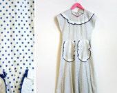 Vintage 1960s White and Blue Polka Dot Tie Back Apron Dress