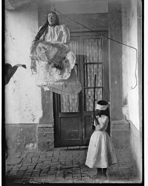 Big lady pinata about to be hit by blindfolded girl old mexico for Odd victorian names