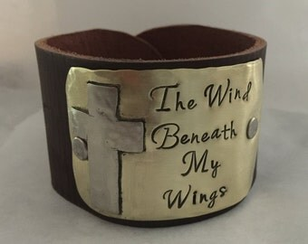 Hand stamped metal, leather cuff bracelet… Wind beneath my wings ... cross, cuff, silver and gold