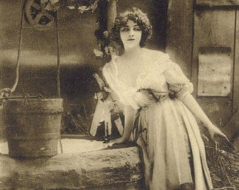 Maiden at the Well 1. Photogravure of Lilian Greuze by Leopold Reutlinger, Posted 1909