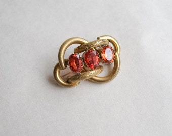 Victorian love knot gold brooch / 1900 orange stones costume jewellery pin