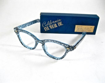 Sparkly cat eye glasses. AMAZING blue glitter confetti lace frames by California Eyewear Inc. New old stock/NOS/deadstock.