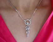 14K white gold diamond necklace.