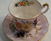 "Paragon Tea Cup and Saucer; Lilac Color; Featuring A Floral Motif From The Oriental Series Titled, ""Sung""  circa 1957-1960's  DR"