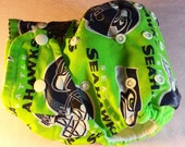 SassyCloth one size pocket diaper with Seahawks neon green cotton print. Made to order.