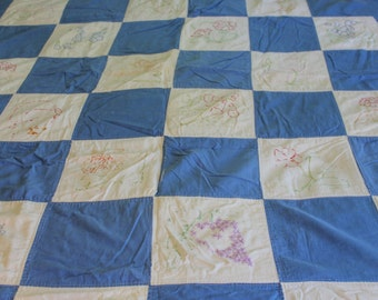 Vintage embroidered quilt handmade patchwork in blue and white