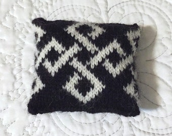 Knitted pincushion -- wool yarn, polyester fill -- black and white