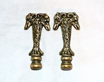 A Pair of Two Headed Rams Tall Lamp Finials in Brass-Plated Iron