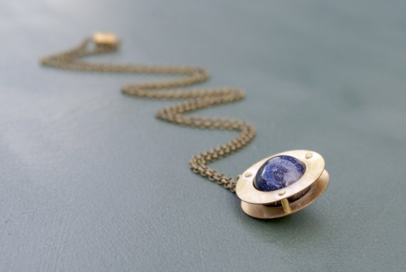 the Riveted Planet necklace