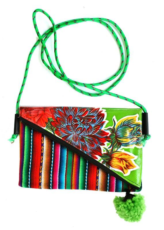 Small, pom pom, adjustable strap, green oil cloth, Peruvian stripes, cross body bag, flat bag