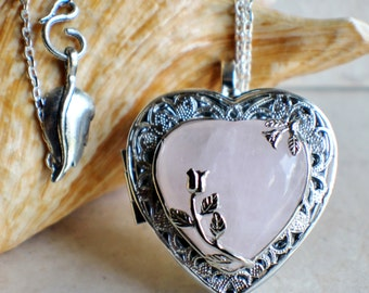 Rose quartz music box locket, heart shaped locket with music box inside, in silver tone with rose quartz crystal heart.
