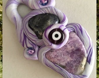The Eye of the Storm Iolite/Purpurite/Blended Clay Evil Eye Pendant