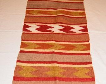 Navajo vintage rug. Small Navajo weaving. Navajo table runner. Cabin decor in orange  earth tones, classic Chinle weaving in wool. bath mat.