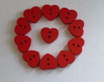 Wooden red heart buttons.  Set of 15.  Measures 15mm x 13mm approx