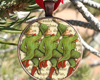 Twelve Days of Christmas Ten Lords A Leaping Christmas Ornament Glass set in a 30mm Copper Finish Pendant Tray With Ribbon