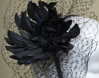 Black flower fascinator with layers of black and pearl veiling.