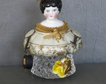China assemblage doll.  Antique china doll head with sugar bowl and crystal body, bees and steampunk arms.