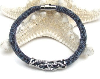 Blue and gray variegated specialty yarn kumihimo bracelet with rhinestone charm and stainless steel magnetic clasp