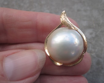 Gorgeous Mabe Pearl Pendant. Iridescent, Surrounded by 14K Gold Mounting.