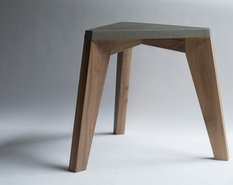 Accent table made of concrete and walnut wood