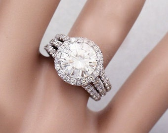 18k white gold round forever one moissanite and diamond engagement ring halo prong set triple shank 3.80ct