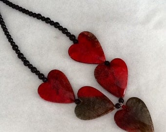 Red heart resin necklace.