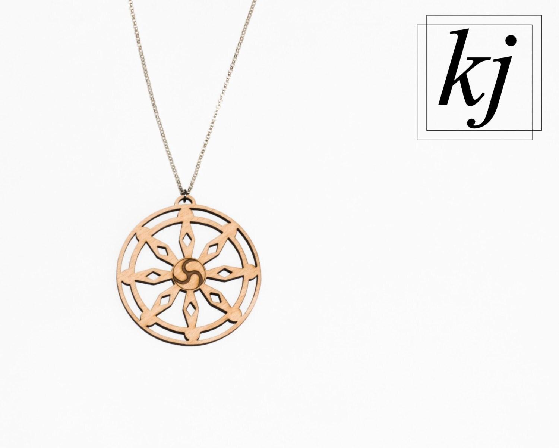 dharmachakra wheel of dharma wooden pendant