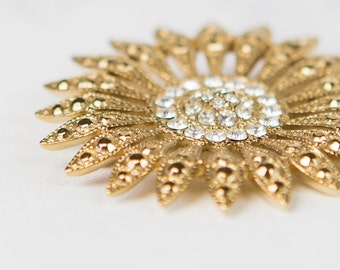 Vintage Starburst/ Sun Brooch - gold metal with rhinestones