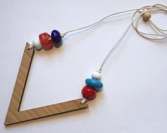 Red, Blue and White Lamp-work glass beads on Wooden V necklace