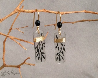 Black tree branch silhouette earrings wirewrapped in gold . Hand-drawn back vine silhouette earrings. Black & gold dangle earrings