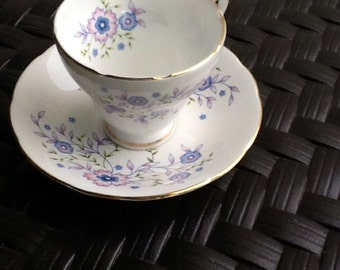 """Avon Bone China Cup/Saucer in Blues and Lavenders Floral Design on White. Circa 1970s. """"Blue Blossoms"""" by Avon Set."""