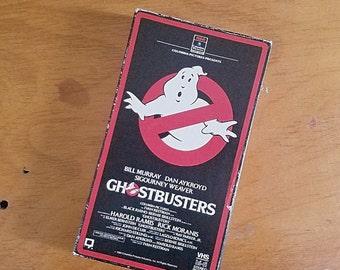 vintage 1980s GHOSTBUSTERS VHS MOVIE. bill murray. dan aykroyd. sigourney weaver. retro. hipster. old school. rad. ghosts. classic. slimer.