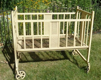 Vintage  baby crib on wheels