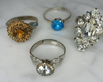Set of Four Silver Tone Rings with Adjustable Bands and Colored Rhinestones