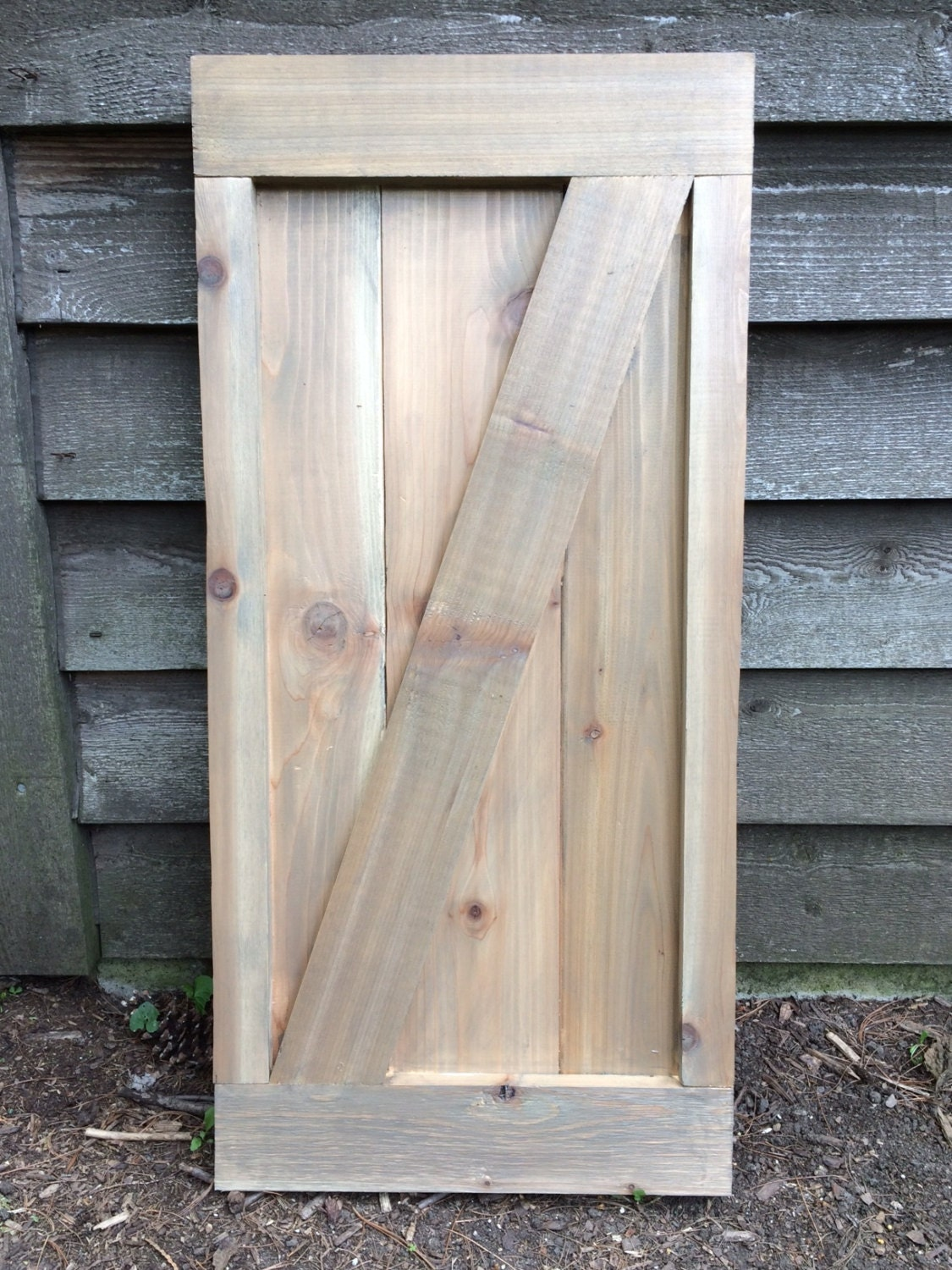 Available framed barn door style cedar shutters exterior for Barn style exterior doors