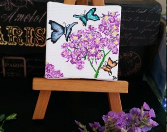 Tiny painting on easel